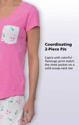 Close-up of Flamingo Stripe PJs top with the following copy: Coordinating 2-Piece PJs. Capris with colorful flamingo print match the chest pocket on a solid scoop-neck tee. image number 3
