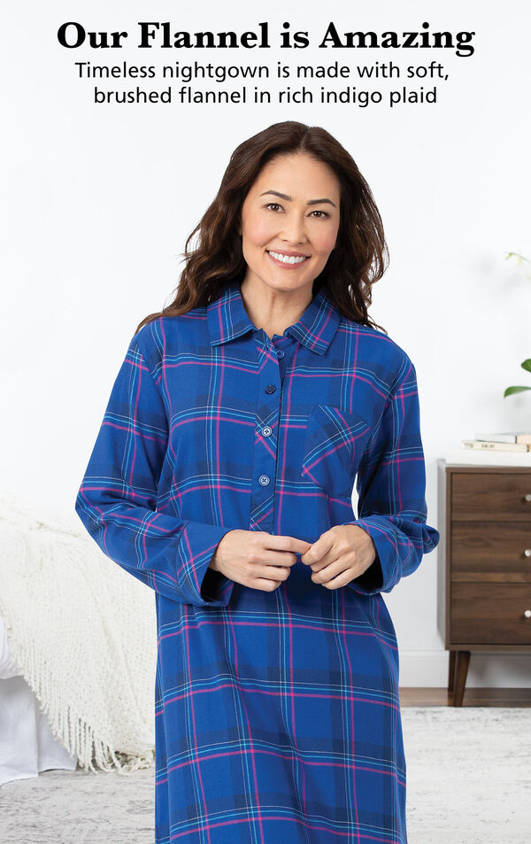 Model wearing Indigo Plaid Nighty by bed with the following copy: Our Flannel is Amazing. Timeless nightgown is made with woven, yarn dyed flannel in rich indigo plaid image number 2