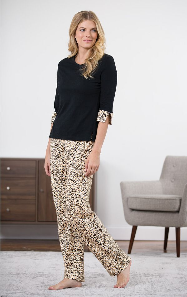 Model standing by chair wearing Leopard Print PJ - Black for Women image number 5