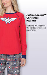 Close-up of Red and Blue Justice League Women's PJ Wonder Woman Top with the following copy: Matching PJs celebrate the holidays with iconic superheroes image number 2
