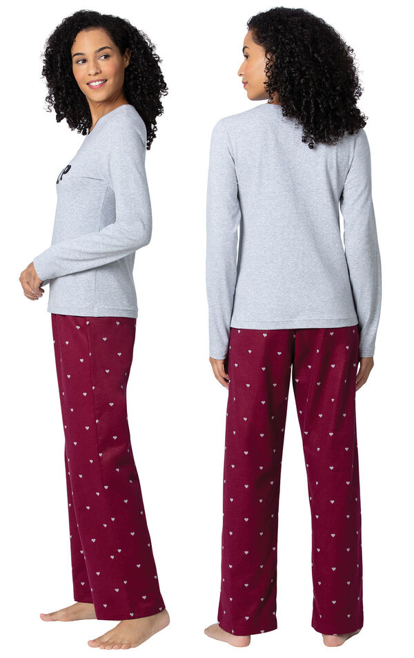 Model wearing Deep Red Hearts PJ for Women, facing away from the camera and then to the side image number 1