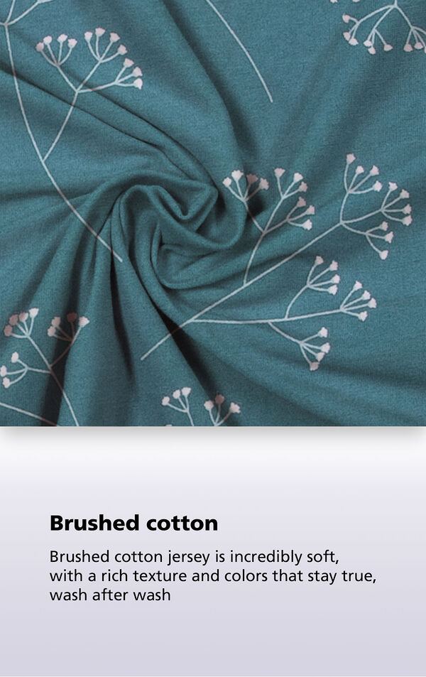 Green Floral Print fabric with the following copy: brushed cotton jersey is incredibly soft, with a rich texture and colors that stay true, wash after wash image number 3