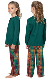 Model wearing Red and Green Christmas Tree Plaid Thermal Top PJ for Girls, facing away from the camera and then to the side image number 1