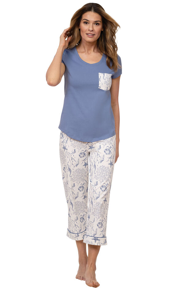 Model wearing Blue and White Seashell PJs for Women with Pocket Short-Sleeve Tee and matching Capris image number 0