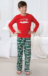 Boy standing by couch wearing Red and Green The Night Before Christmas Boys' Pajamas image number 1