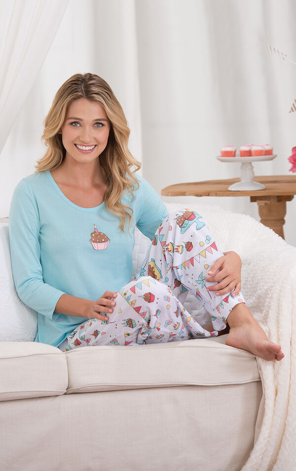 Model sitting on couch wearing Light Blue and White Happy Birthday Pajamas image number 2