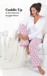 Model sitting on couch wearing Snuggle Fleece Hoodie Pajamas with the following copy: Cuddle Up in our Exclusive Snuggle Fleece image number 2