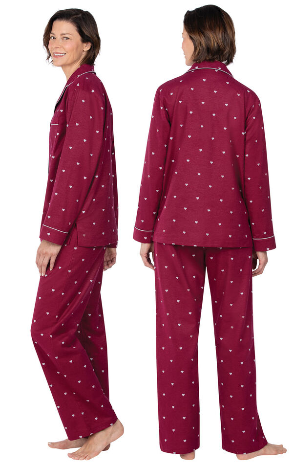 Model wearing Deep Red Hearts Flannel Button-Front PJ for Women, facing away from the camera and then to the side image number 1