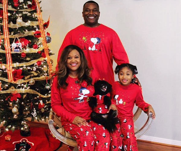 An image of a family wearing matching Snoopy & Woodstock pajamas