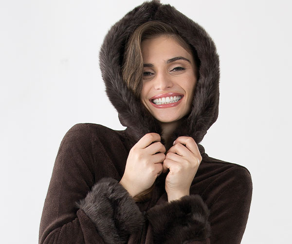 A model wearing PajamaGram Hoodie-Footie Mink Pajamas