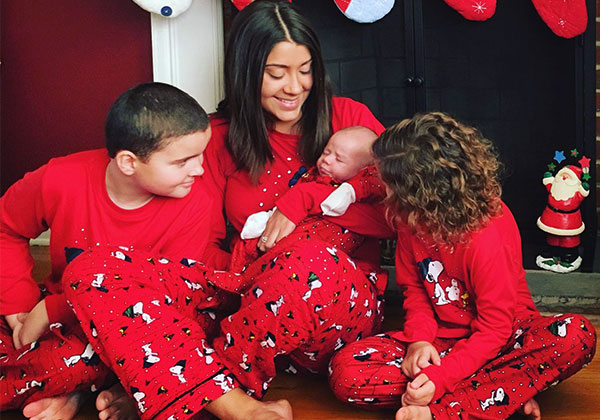 An image of a family wearing Snoopy & Woodstock Matching Family Pajamas