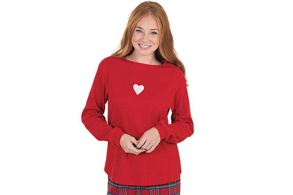 A model wearing Pajamagram Valentine's Day Plaid pajamas