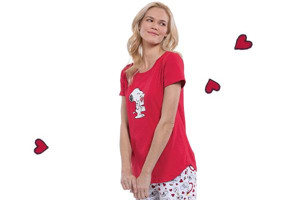 A model wearing Pajamagram Snoopy's Valentine pajamas