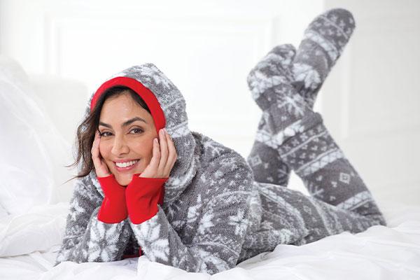 An image of a model wearing Nordic Hoodie-Footie pajamas