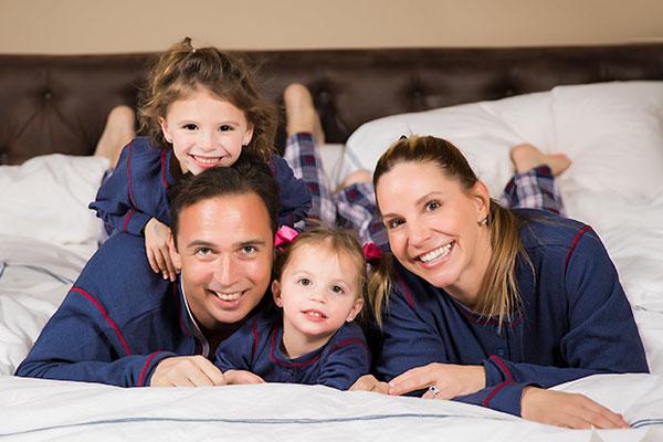 An image of a family wearing PajamaGram Snowfall Plaid Matching Family Pajamas