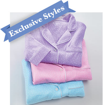 A vertical stack of 4 pajama tops