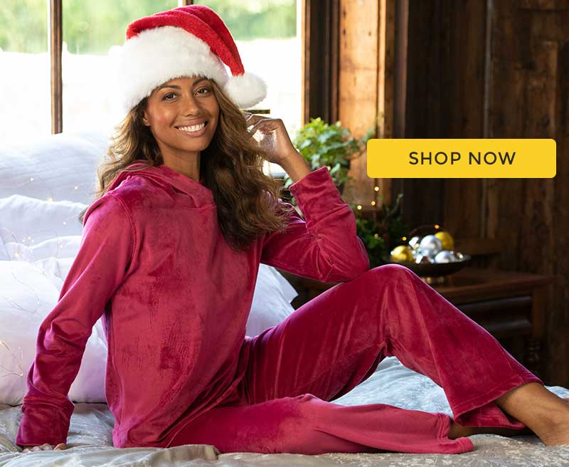 A model wearing PajamaGram Tempting Touch pajamas in garnet