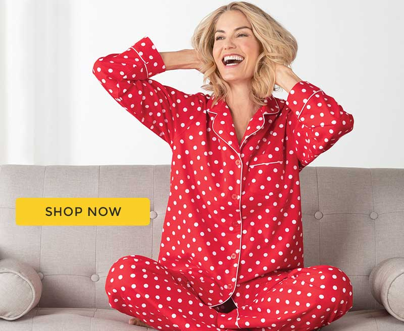 A model wearing PajamaGram Red Polka-Dot Boyfriend pajamas