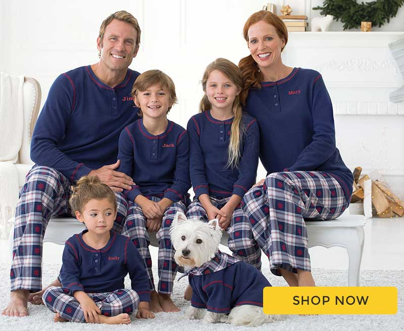 A family wearing our Snowfall Plaid Matching Family pajamas