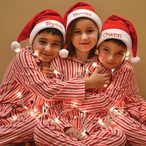 Image of 3 children wearing PajamaGram Candy Cane Fleece pajamas
