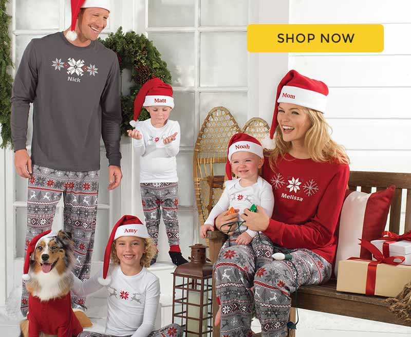 A family wearing matching PajamaGram Nordic Family pajamas